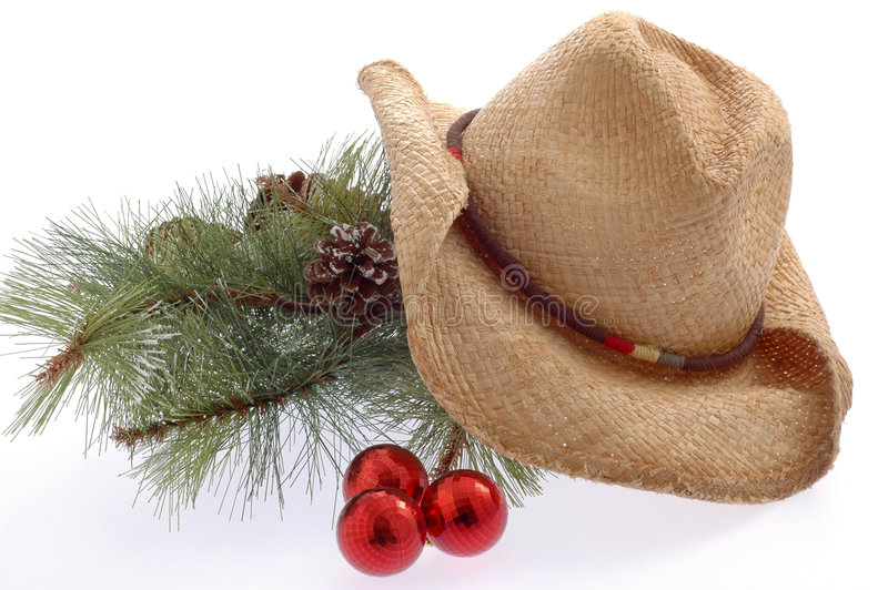 Country Christmas. Pine bough and well worn cowboy hat on white background royalty free stock photos