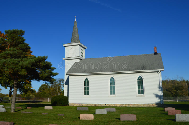 Country Church with Cemetery. An old, white country church and cemetery, located in Honey Creek, Wisconsin stock image
