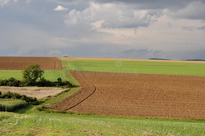 Country colors, thüringen. Landscape with different colors of hilly fields under a thundery sky royalty free stock photos