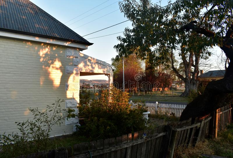 Country cottage charm with an old fence royalty free stock photo