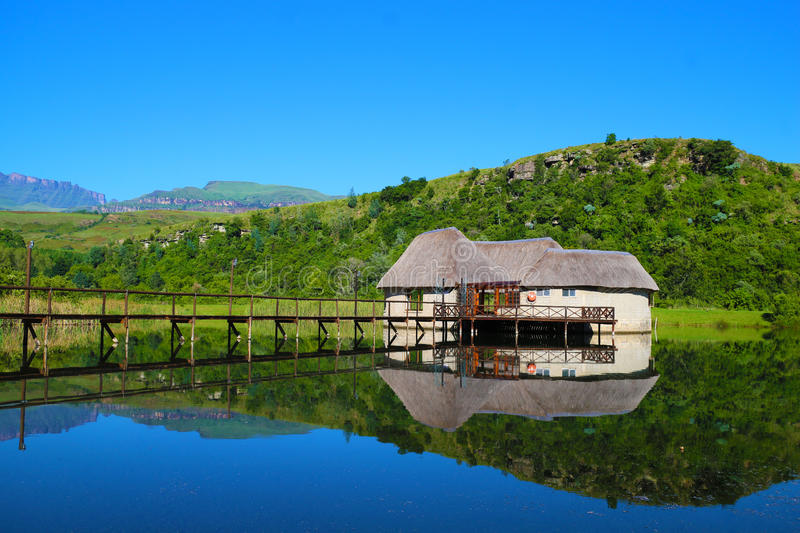 Country cottage floating in a lake stock photography