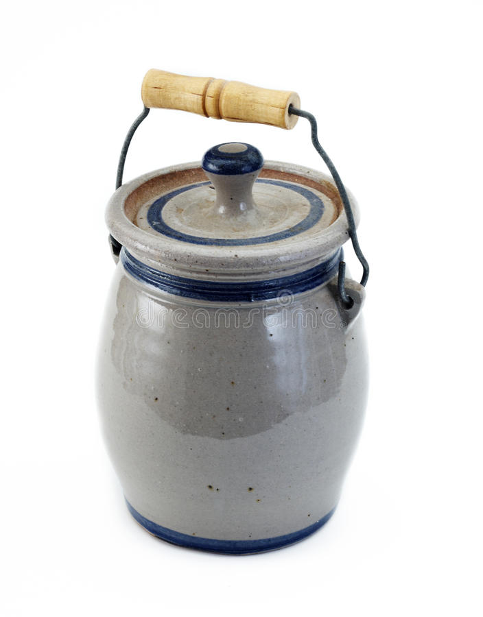 Country crock. Blue Country crock with handle on a white background royalty free stock photo
