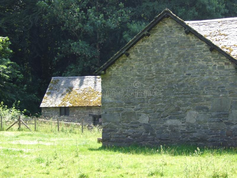Country Dwelling. Country Cottage and Workhouse on a sunny summers day on a Forest edge stock photos