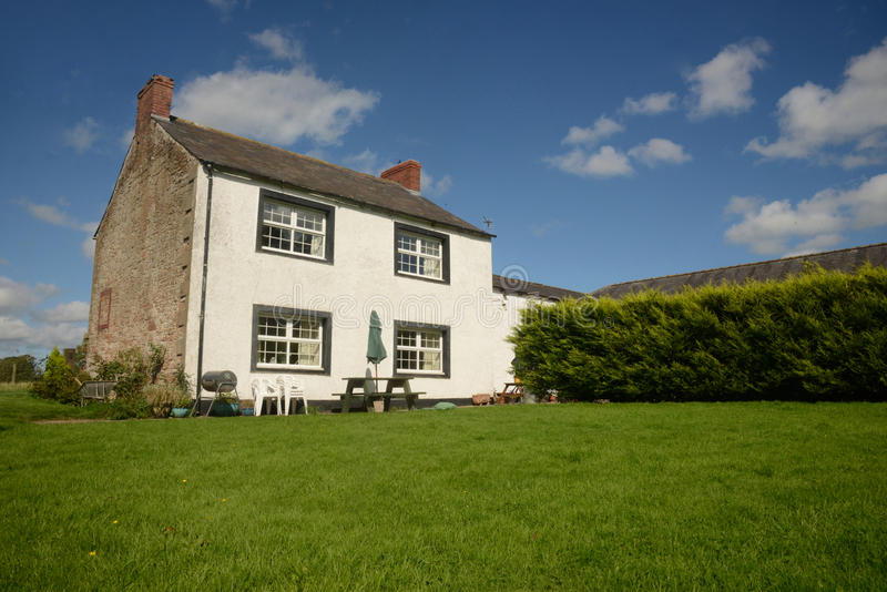 Country farm house with lawn royalty free stock photography