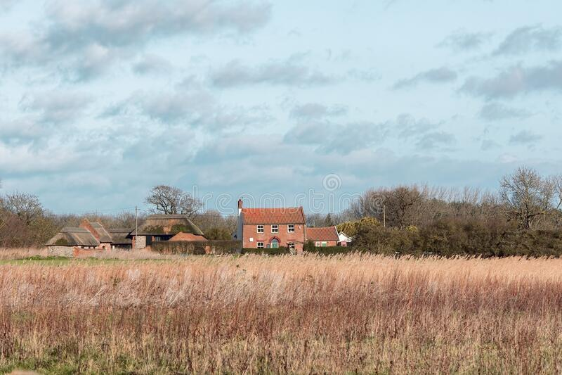 Country farmhouse living. Rural English countryside agricultural landscape scene royalty free stock photos