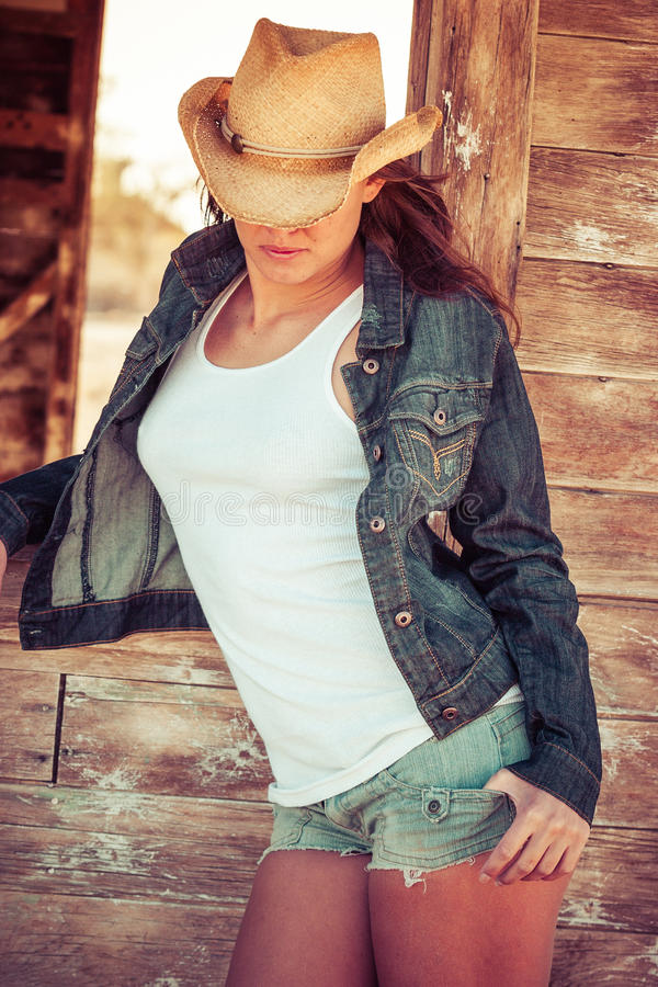 Country Fashion Girl. Beautiful young country fashion girl royalty free stock images