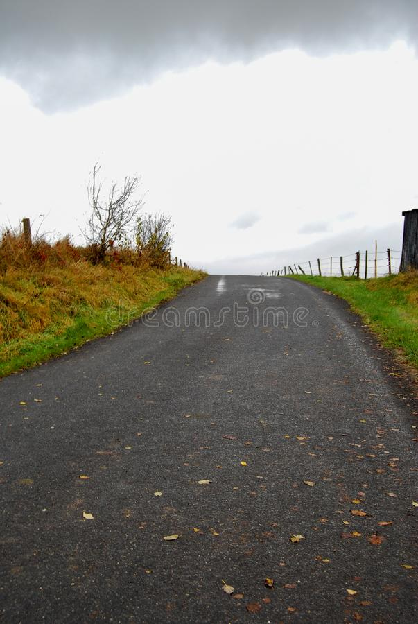 Country field road on a grey cloudy day. Rural and landscape photography in countryside royalty free stock images