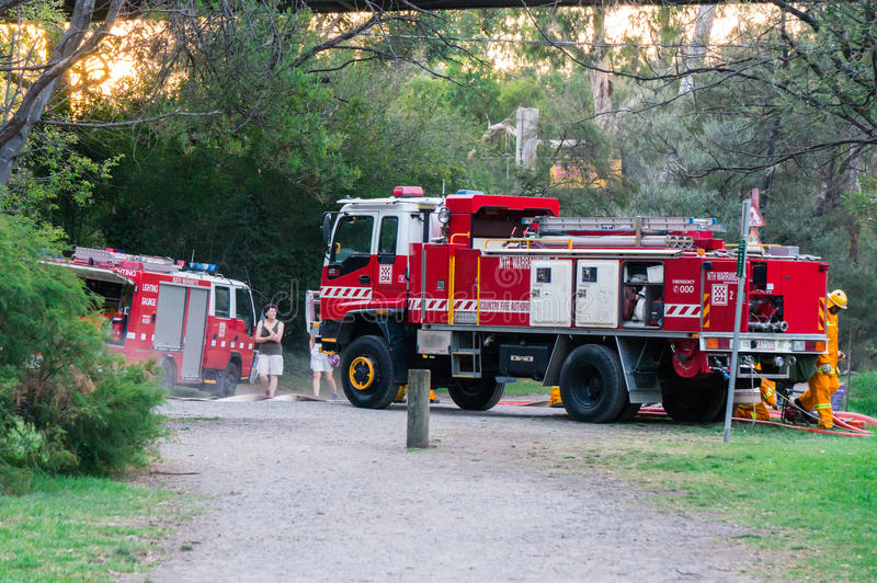 Country Fire Authority fire fighters in Melbourne, Australia. Fire fighters from the North Warrandyte brigade of the Country Fire Authority, practicing by the stock photography