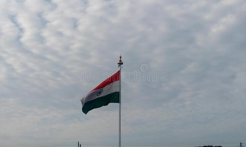 Country Flag of India floating and waving at the air due to wind speed. Picture of India country flag in a flagpole in front of chennai international airport as royalty free stock images