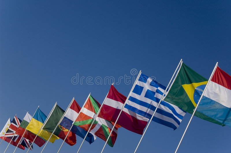 Country flags. In a blue sky royalty free stock images
