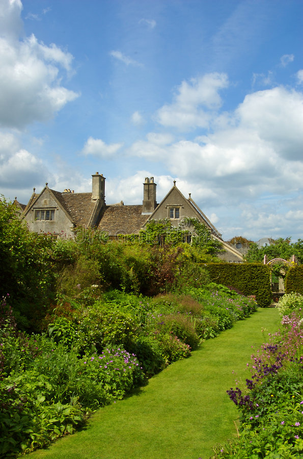 Country Garden. A beautiful english country garden on a hot early summer day royalty free stock images