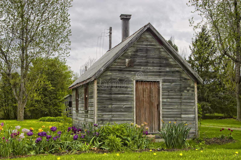 Country Garden Shed. A rustic quaint country garden shed with a row of flowerw around it royalty free stock images