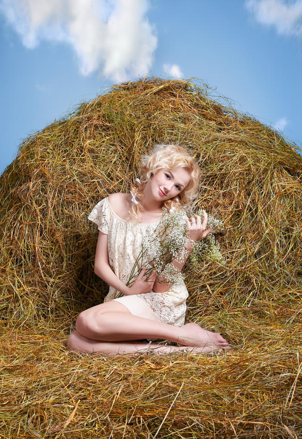 Country girl on hay stock photo