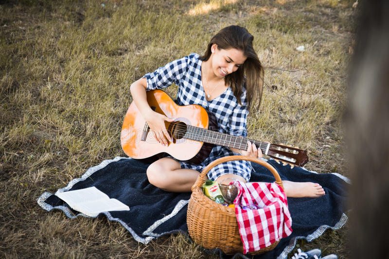 Country girl plays guitar royalty free stock images
