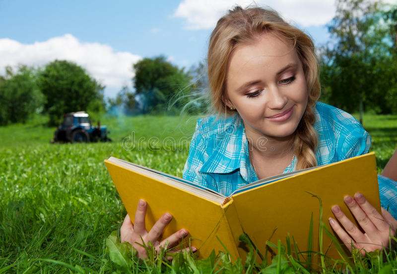 Country girl reading a book stock image