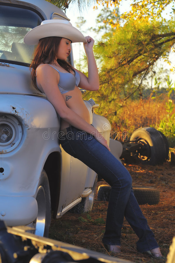 Country girl with red hair and white hat royalty free stock photo