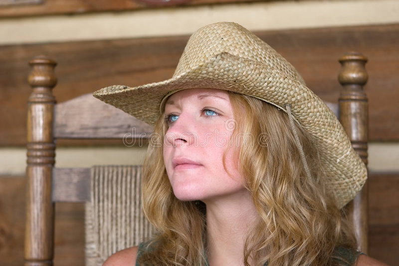 Country girl in straw hat. royalty free stock photo