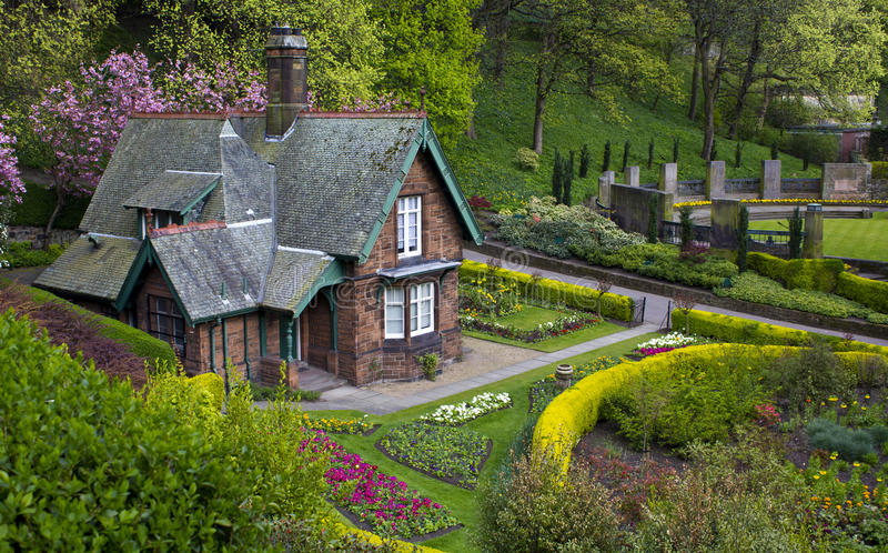 Country House. House in the country surrounded by flower garden stock image