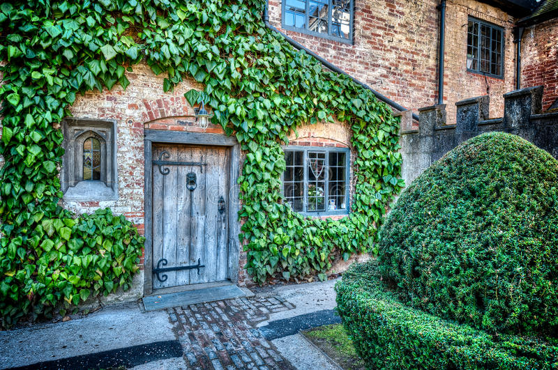A Country House. A doorway to a wonderful country house, with vines growing on the walls royalty free stock photos