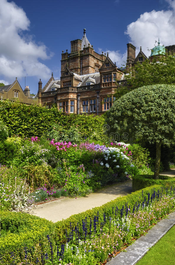 Country house and garden. Exterior of luxurious English country house with garden in foreground royalty free stock image