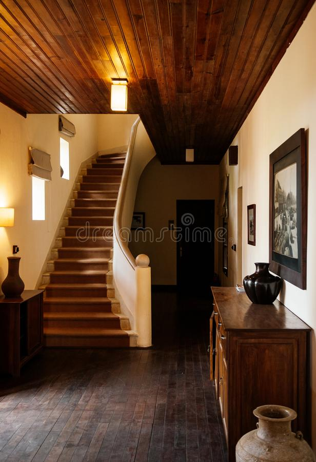 Country house hallway with stairwell and wood furniture royalty free stock photography