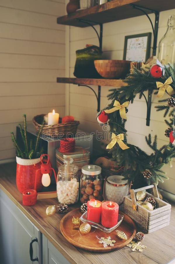 Country house kitchen decorated for Christmas and new year Holidays. Marhmallows, candles, cocoa and nuts in modern jars. Celebrating at home royalty free stock image