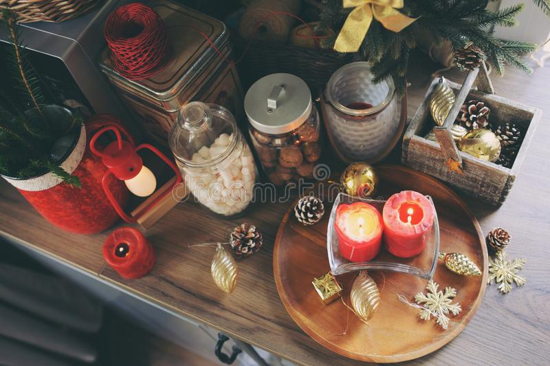 Country house kitchen decorated for Christmas and new year Holidays. Marhmallows, candles, cocoa and nuts in modern jars. Celebrating at home stock photos