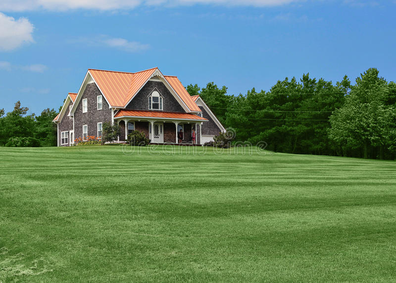 Country house and lawn. A well-kept, country house with a large, green lawn stock images