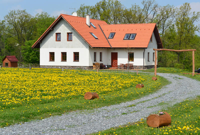 Country house. With meadow and dandelions in blossom, Czech republic stock image
