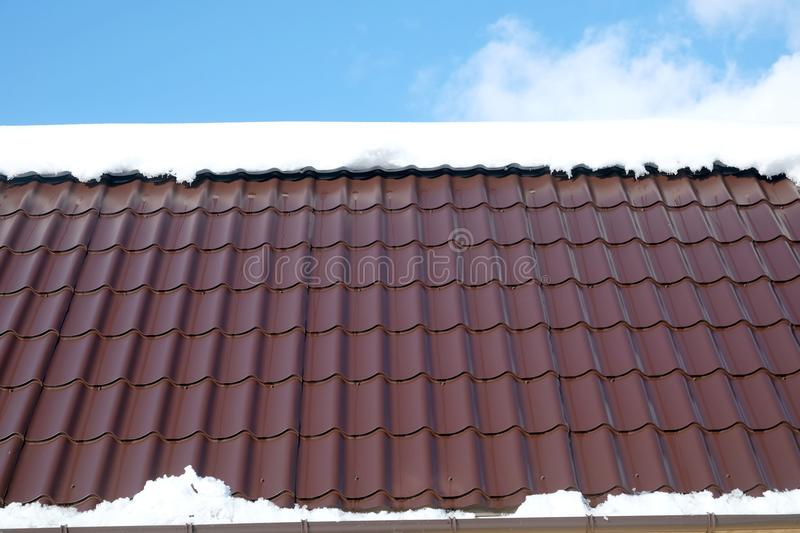 Download Country House Roof From Brown Metal Tile With Snow In Sunny Spring  Day Under Blue