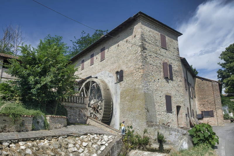 Country house with watermill near Castell`Arquato royalty free stock image