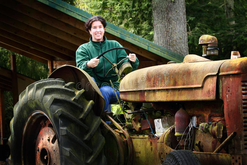 A Country Lady Driving Old Tractor stock image