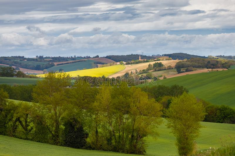 Country landscape in `Occitanie`, south of Toulouse, France. Cloudy sky royalty free stock photo