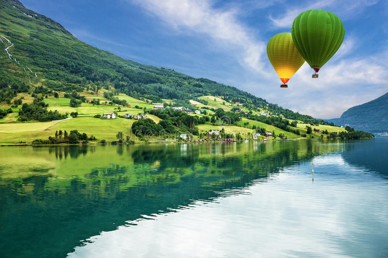 Country landscape, Olden, Norway. Hot air balloons royalty free stock images
