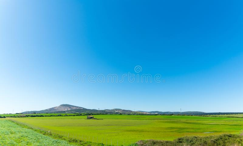 country landscape with a small house royalty free stock images