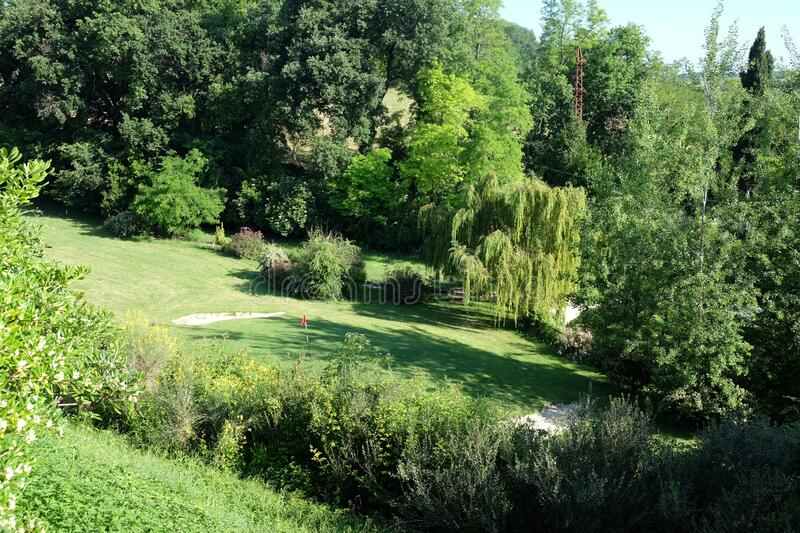 Garden golf club. Country life scene, the garden. The image is featuring golf club royalty free stock photos