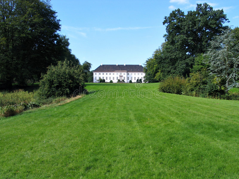 Country mansion house Denmark. Big country farm mansion house with wide lawn area Denmark royalty free stock images