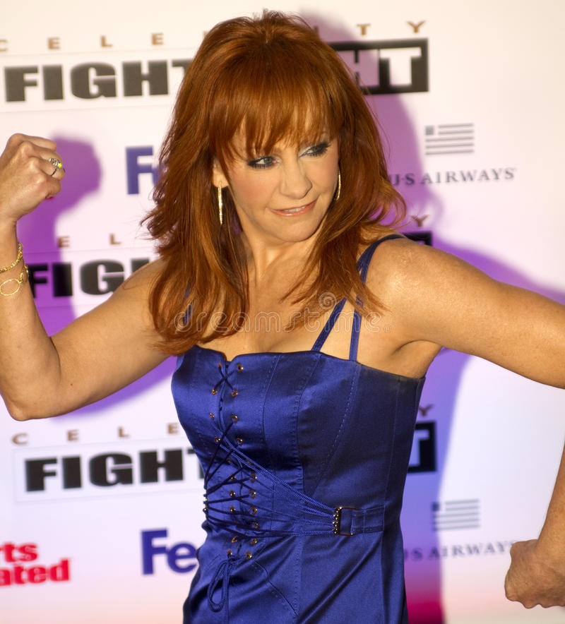 Country music artist and actress Reba McEntire. American country music artist and actress, Reba McEntire, attends Celebrity Fight Night on March 19, 2001, at the stock images