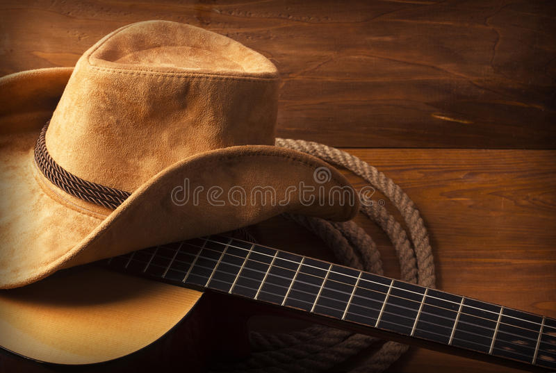 Country music background with guitar. American Country music background with guitar and cowboy hat royalty free stock photography