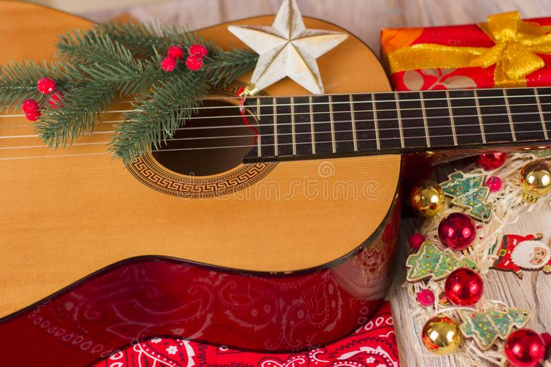 Country music christmas background with guitar and cowboy bandanna. Country music christmas background with guitar and red bandanna royalty free stock photography