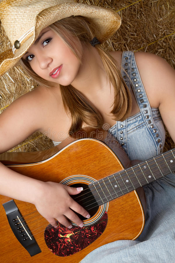 Country Music Girl. Playing guitar royalty free stock photos