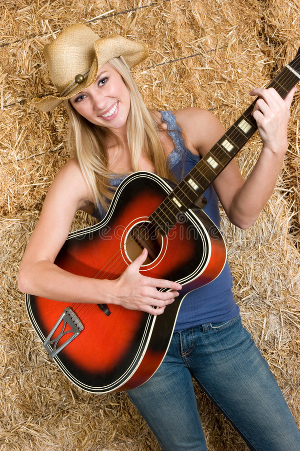 Country Music Girl. Beautiful smiling country music girl royalty free stock photo