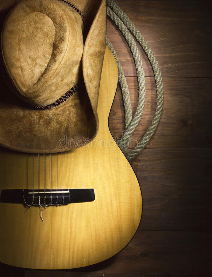 Country music with guitar on wood background. American Country music with guitar and cowboy hat on wood background stock photo
