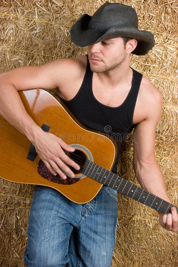 Country Music Man. Playing guitar royalty free stock images