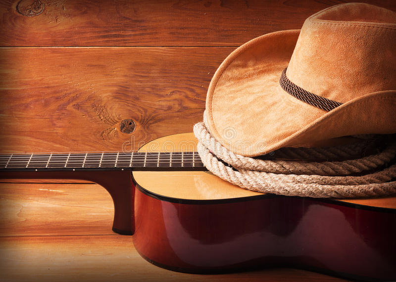 Country music picture with guitar and cowboy hat. And lasso stock photography