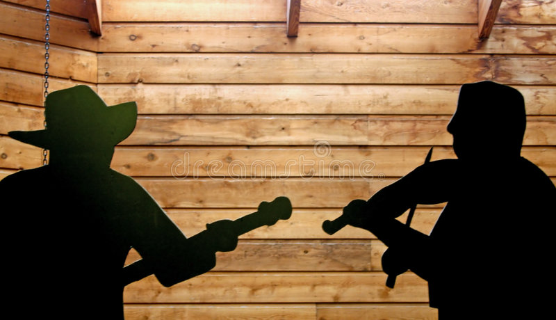Country Music Silhouette. A Country Music Silhouette Set Against A Rustic Woodgrain Background royalty free stock images