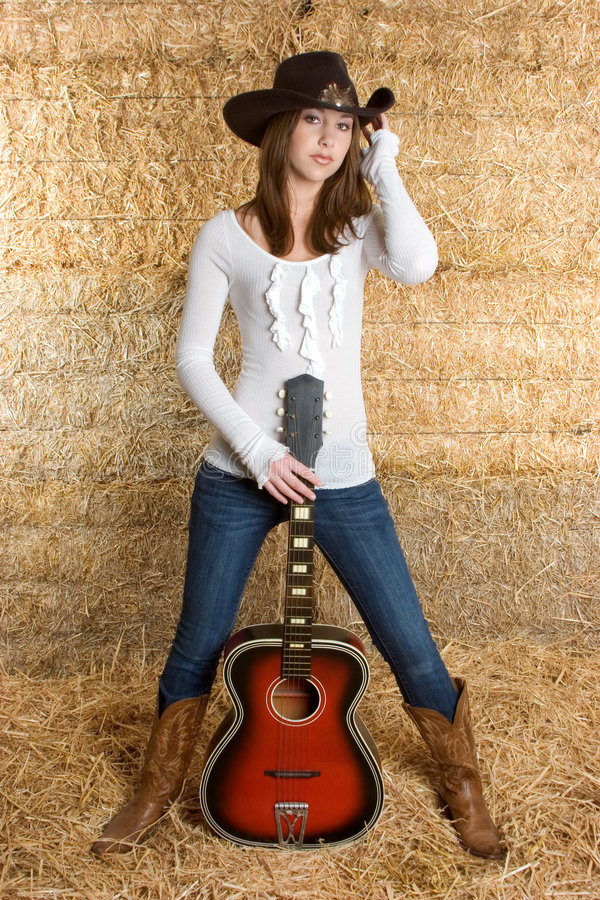 Country Music Woman. Beautiful country music guitar woman stock images