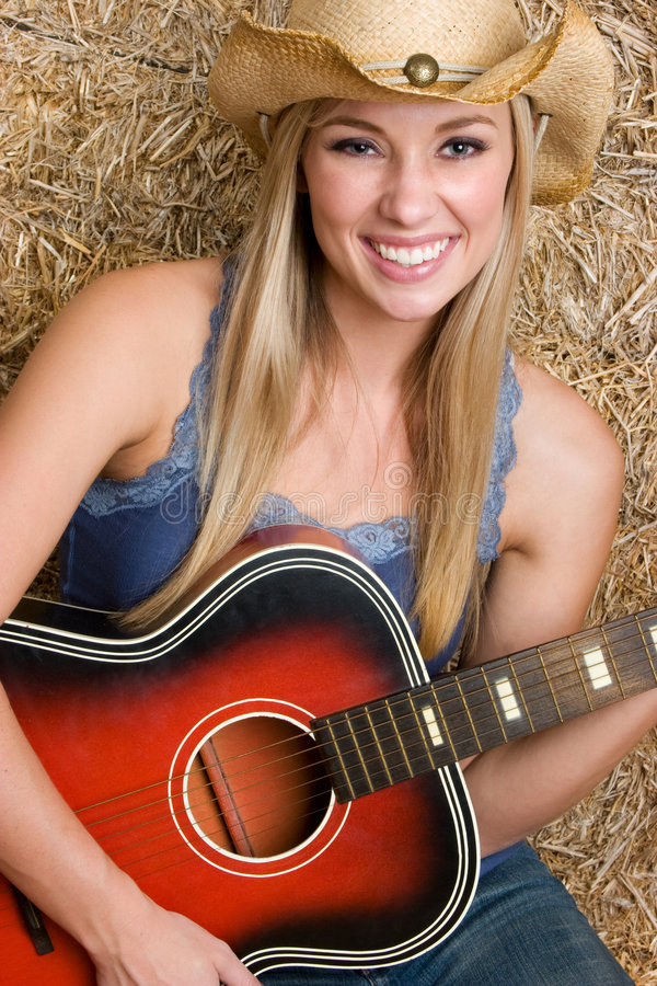 Country Music Woman. Beautiful country music guitar woman stock image