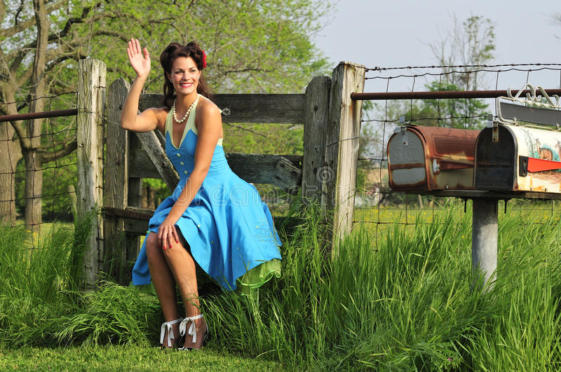 Country pin up girl in a farm stock image