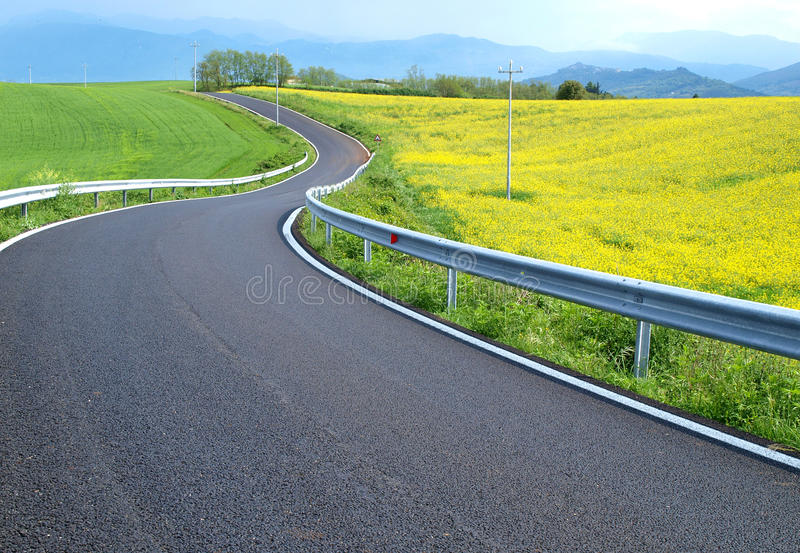 Country road. Across colorful fields, Italy stock photography